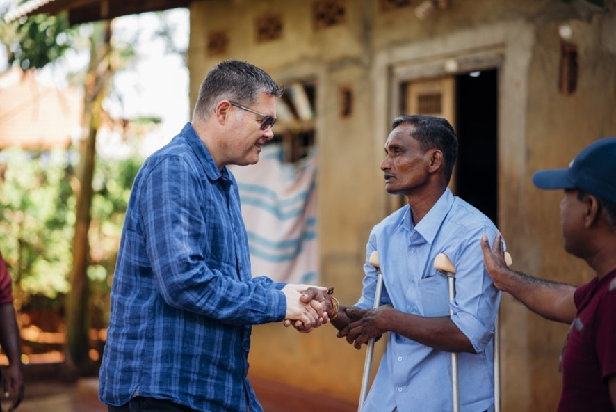 The Leprosy Mission's National Director shaking hands with Jegathees, a man affected by leprosy and leprosy disability